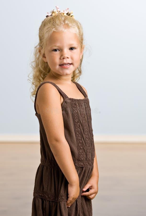 Smiling girl wearing dress stock photo