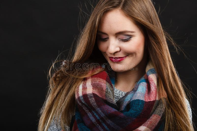 Smiling girl wearing warm wooden scarf royalty free stock images
