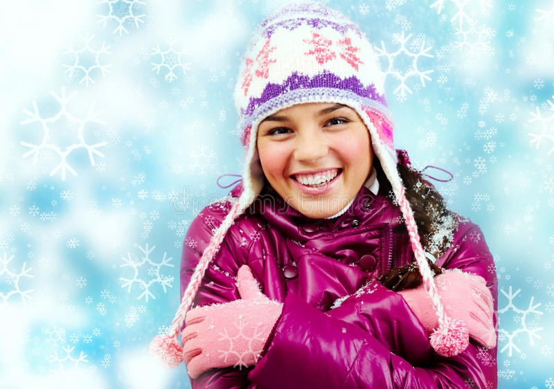 Smiling girl in winter royalty free stock images