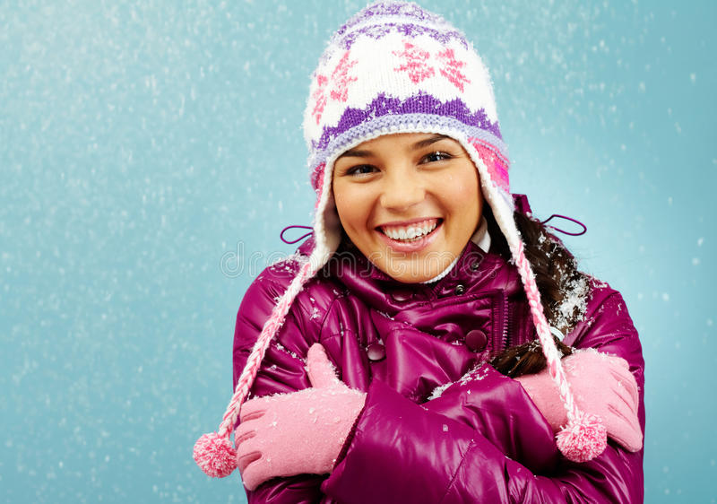 Smiling girl in winter royalty free stock photography