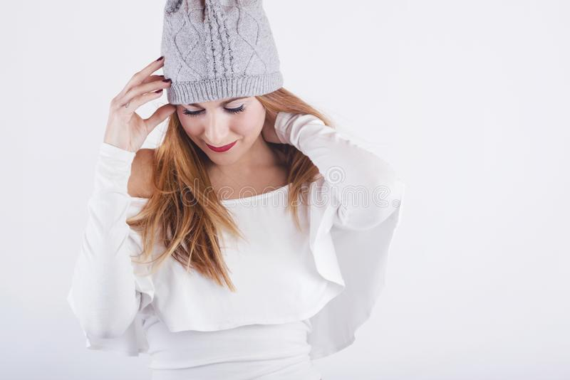 Smiling girl with winter hat. On white background royalty free stock photos