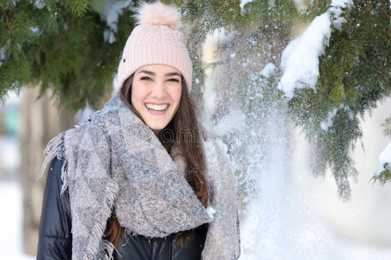 Smiling girl in winter with snow and christmas tree. Portrait of Smiling girl in winter with snow and christmas tree stock photography