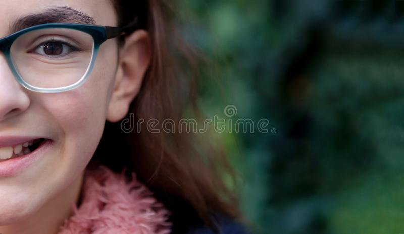 Teenager girl with scarf in the garden stock photo
