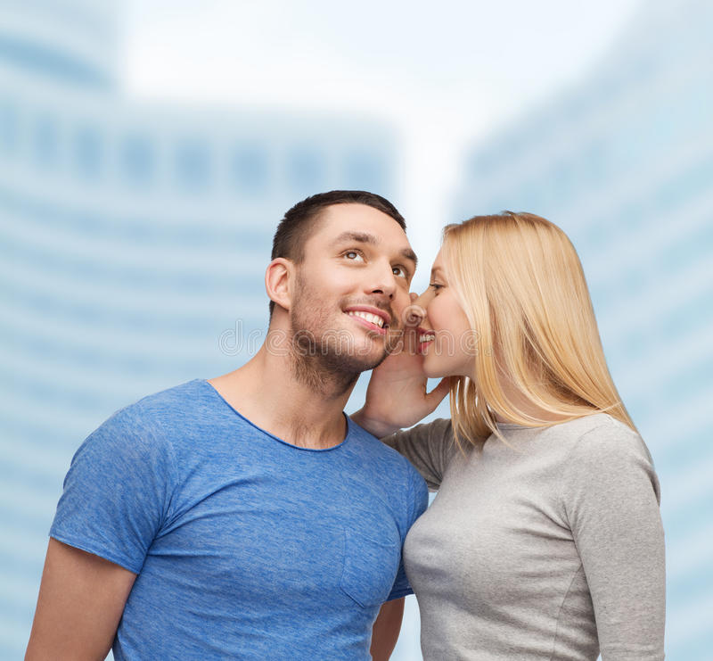 Smiling Girlfriend Telling Boyfriend Secret Stock Photo