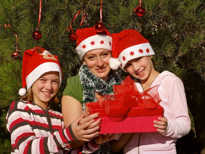 Smiling girls with Christmas gift royalty free stock photography