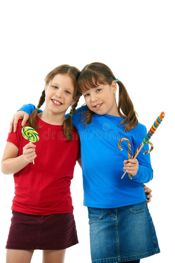 Download Smiling Girls With Lollipops Stock Image - Image: 22787839