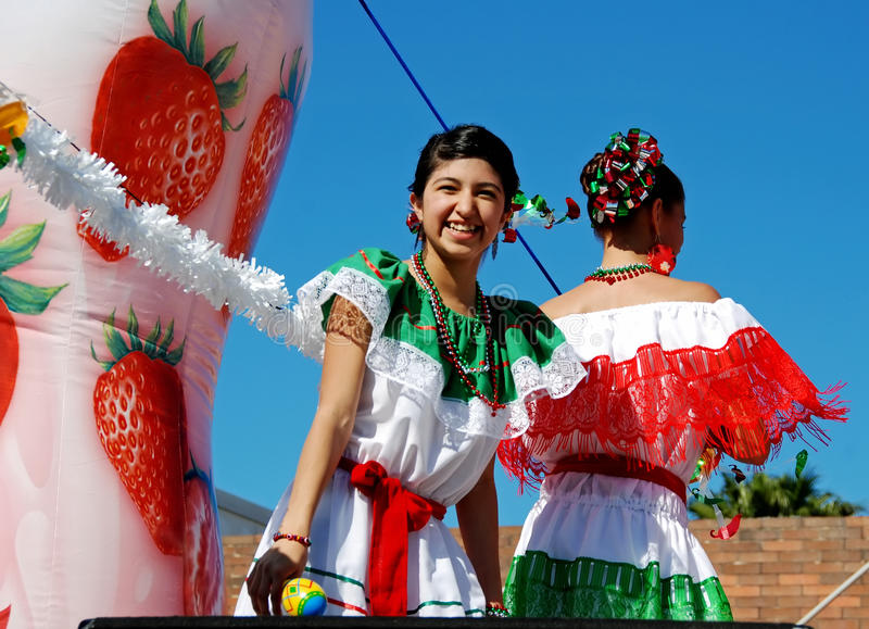 Smiling girls on parade float royalty free stock photography