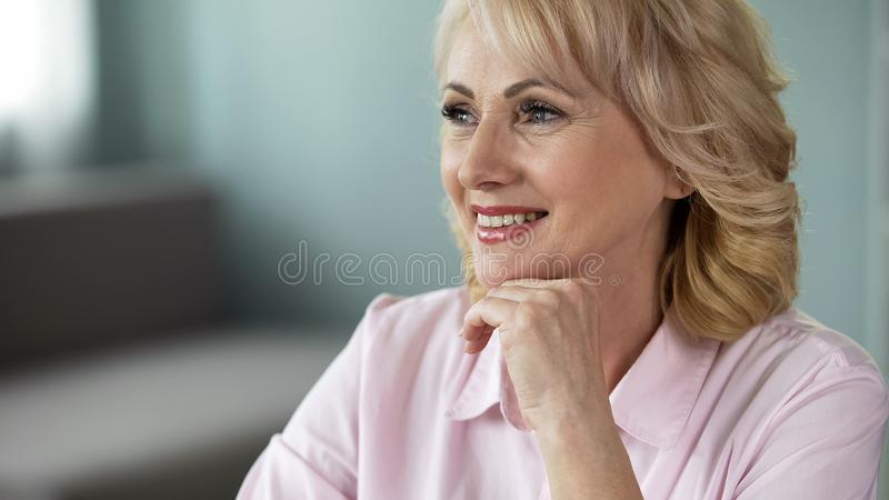 Smiling good-looking senior woman dreaming, inner and outer harmony, happiness. Stock photo royalty free stock photos