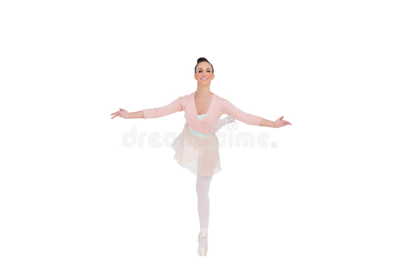 Smiling gorgeous ballerina standing in a pose royalty free stock photography