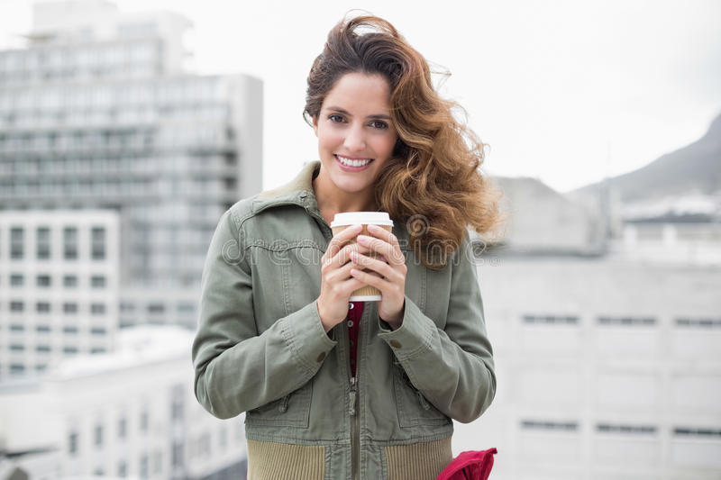 Download Smiling Gorgeous Brunette In Winter Fashion Holding Disposable Cup Stock Image - Image: 34397271