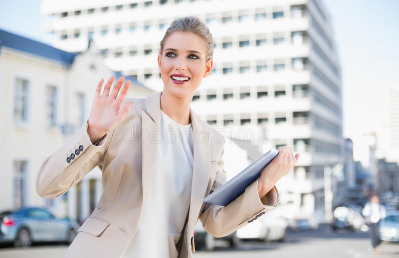 Download Smiling Gorgeous Businesswoman Holding Tablet Pc Waving Stock Image - Image: 33847837