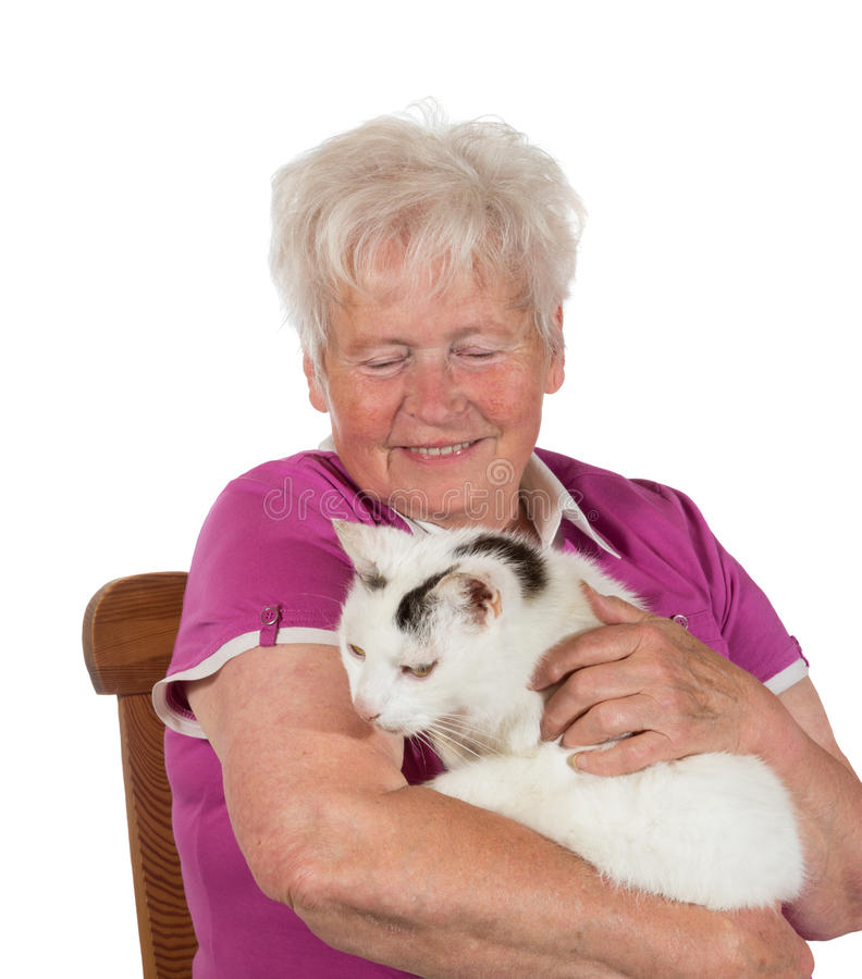 Smiling granny holding her cat stock photo