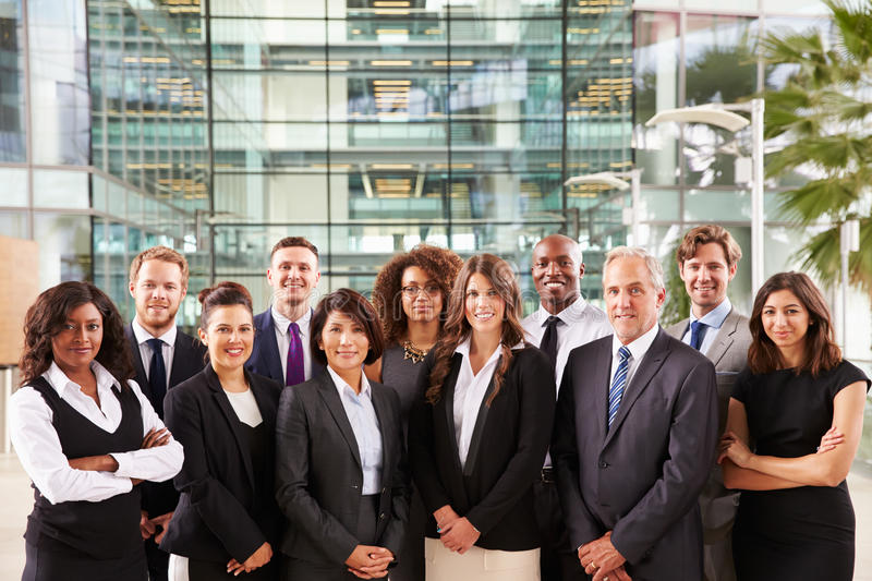 Smiling group portrait of corporate business colleagues stock photos