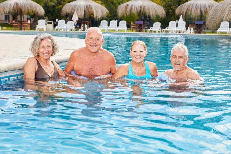 Smiling group of seniors in the spa makes hydrotherapy. In rehab stock images