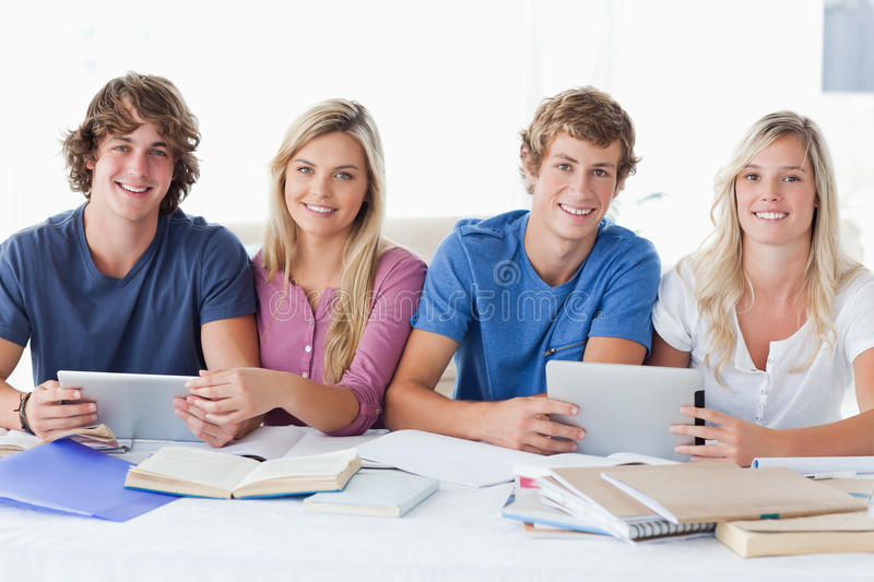 Download A Smiling Group Of Students Looking At The Camera Stock Photo - Image: 25336152
