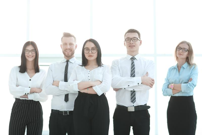 Smiling group of young professionals standing together royalty free stock images