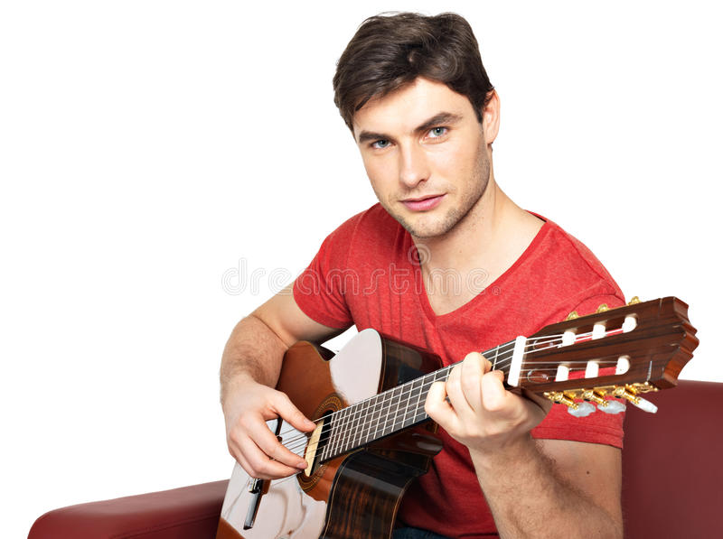 Smiling guitarist plays on the acoustic guitat royalty free stock image