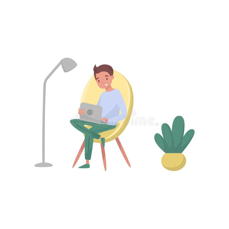 Smiling guy sitting on armchair and using laptop. Profession of graphic designer. Young freelancer working at home. Flat royalty free illustration