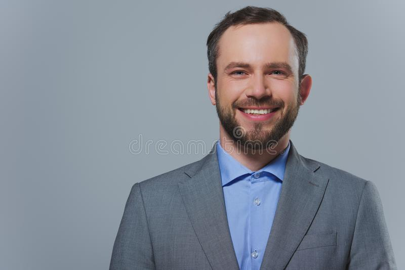smiling handsome businessman looking at camera stock photo