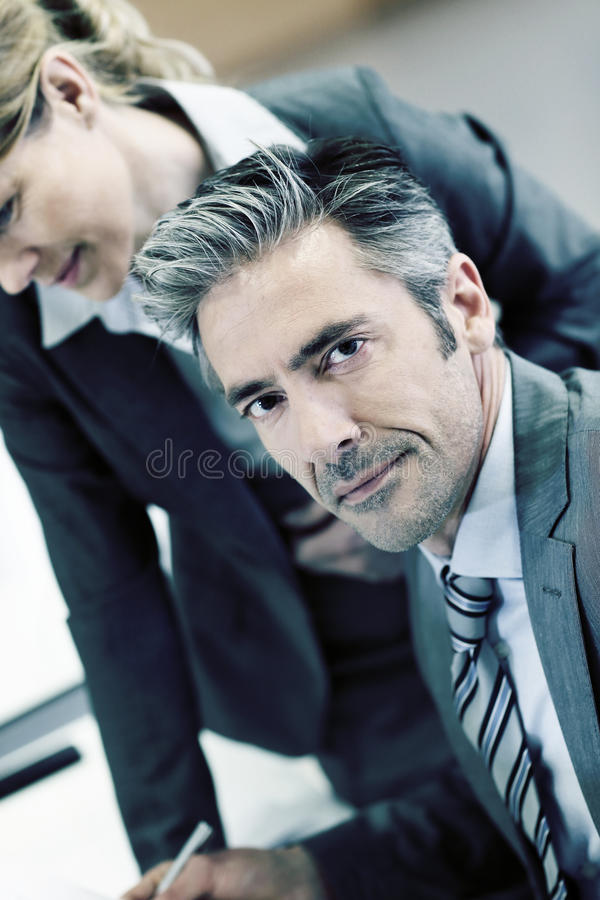 Smiling handsome businessman woking stock photography