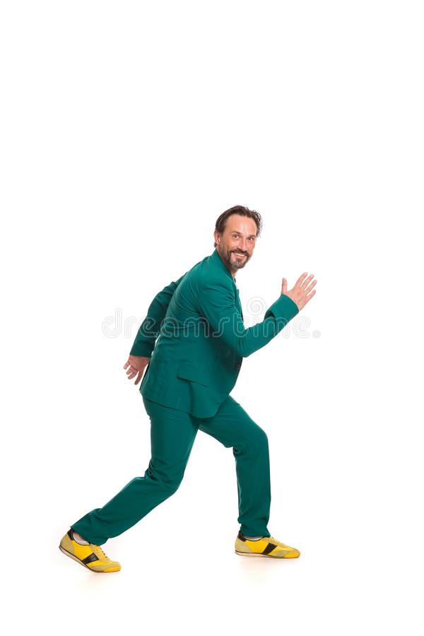 Handsome man in green suit. Smiling handsome man in green suit. Isolated on white background stock photo