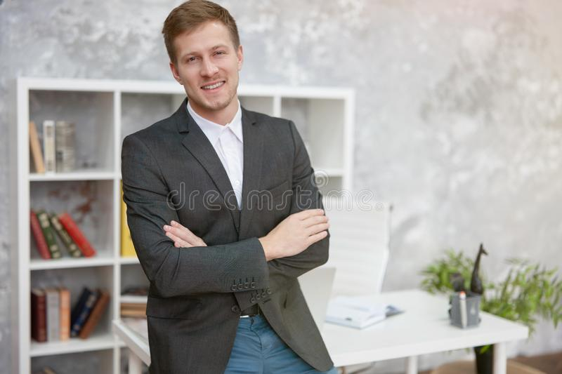 Smiling handsome man manager standing in his office at his looking confident .bussiness, work concept stock photos
