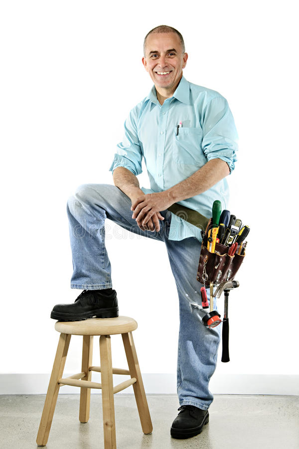 Smiling handyman royalty free stock images
