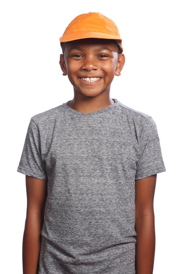 Smiling happy African American boy in orange cap stock image