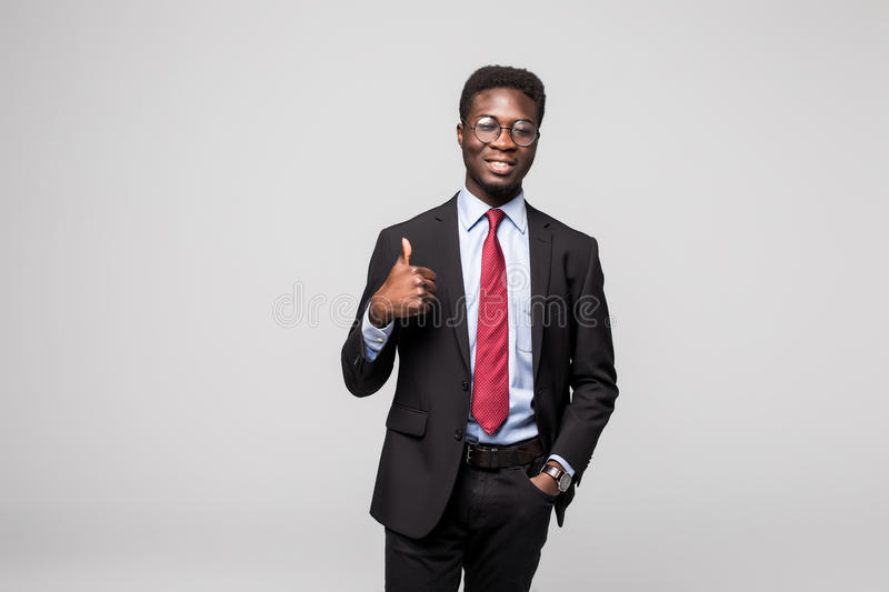 Smiling happy african black executive professional giving a thumbs up in studio stock image