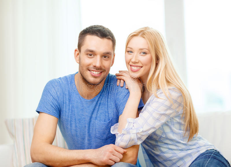 Smiling happy couple at home stock photos