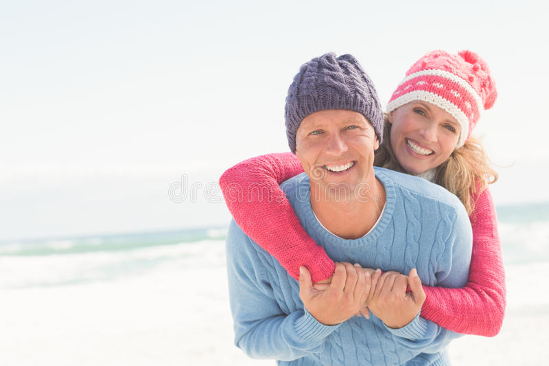 Smiling happy couple hugging each other stock photo
