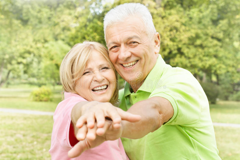 Smiling happy elderly couple royalty free stock photography