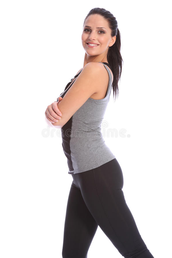 Smiling happy fitness woman arms folded in studio royalty free stock photo