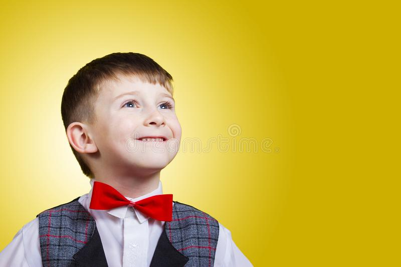 Smiling, Happy, Joyful beautiful little boy, looking up.Close-up Studio Portrait isolated on blue background. royalty free stock photo