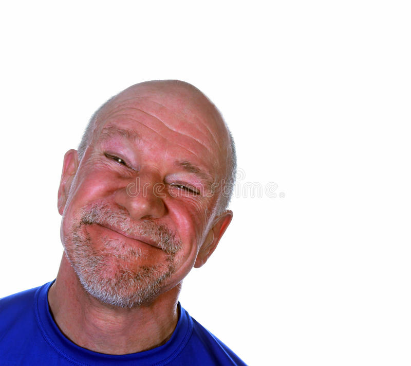 Smiling Happy Senior. A happy senior man with a broad smile and a ruddy complexion royalty free stock photography