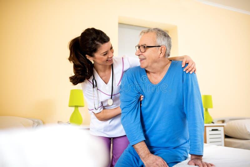 Smiling happy senior man at nursing home royalty free stock photos