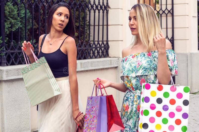 Smiling women with a lot of shopping bags royalty free stock image