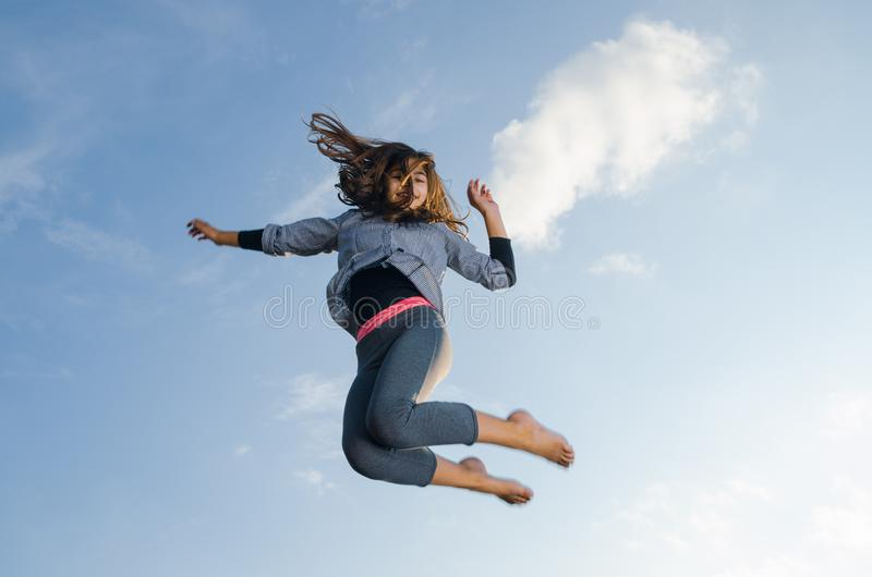 Gymnast girl jumping royalty free stock photography