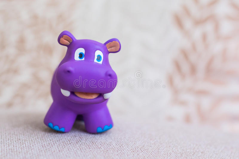 Smiling hippo toy violet stock image