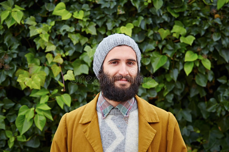 Smiling hipster bearded male student royalty free stock images