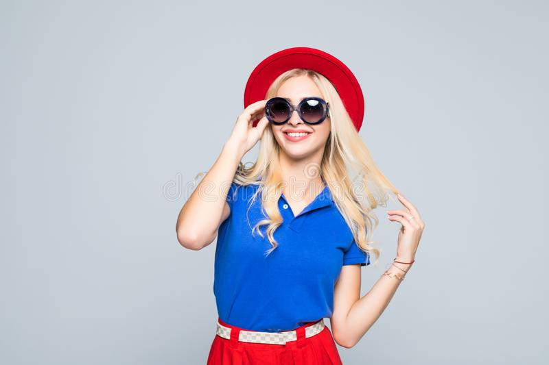Smiling Hipster Girl Trendy Casual Fashion Outfit in Spring or Autumn isolated on gray background stock images