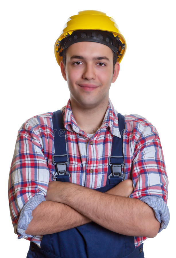 Smiling hispanic construction worker with crossed arms stock images