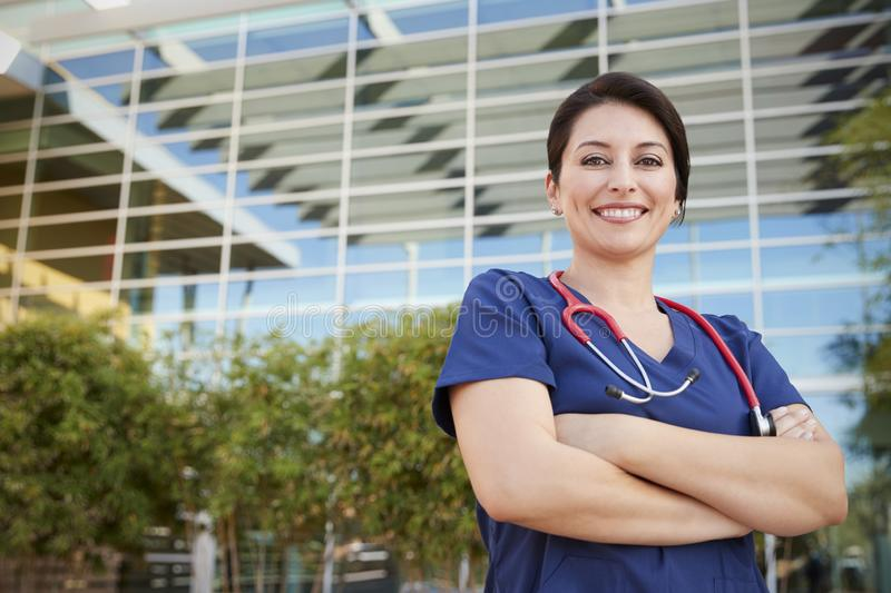Smiling Hispanic female healthcare worker outdoors, portrait royalty free stock photos