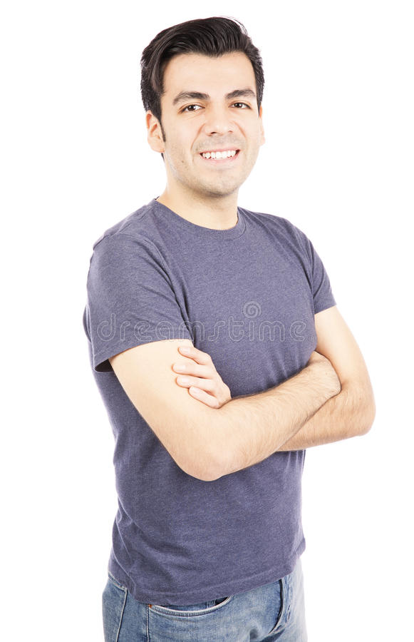 Smiling hispanic man. Portrait of happy Hispanic man standing with arms crossed on white background royalty free stock photo