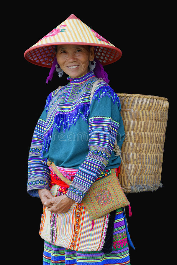 Smiling HMong woman with a basket on her back royalty free stock photography