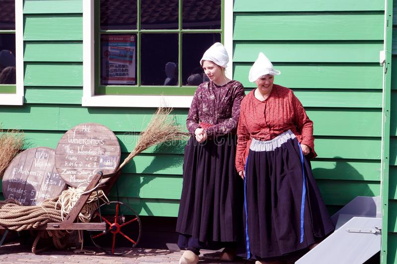 Smiling holland women. Smiling women in Zaanse Schans ethnographic museum in Netherlands royalty free stock image
