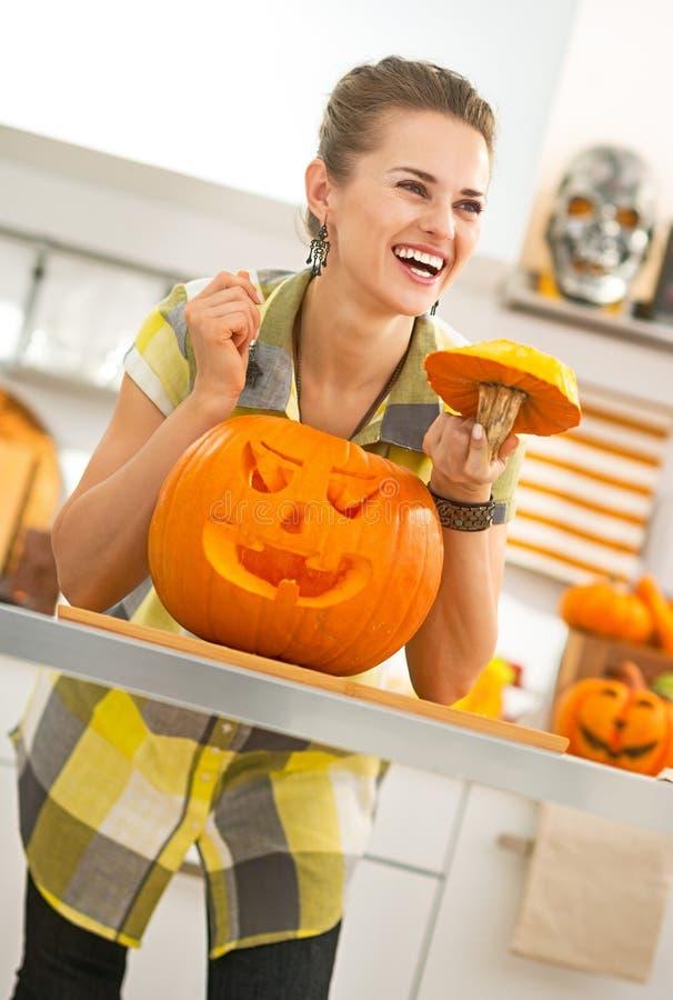 Smiling housewife with a big orange pumpkin Jack-O-Lantern stock photos
