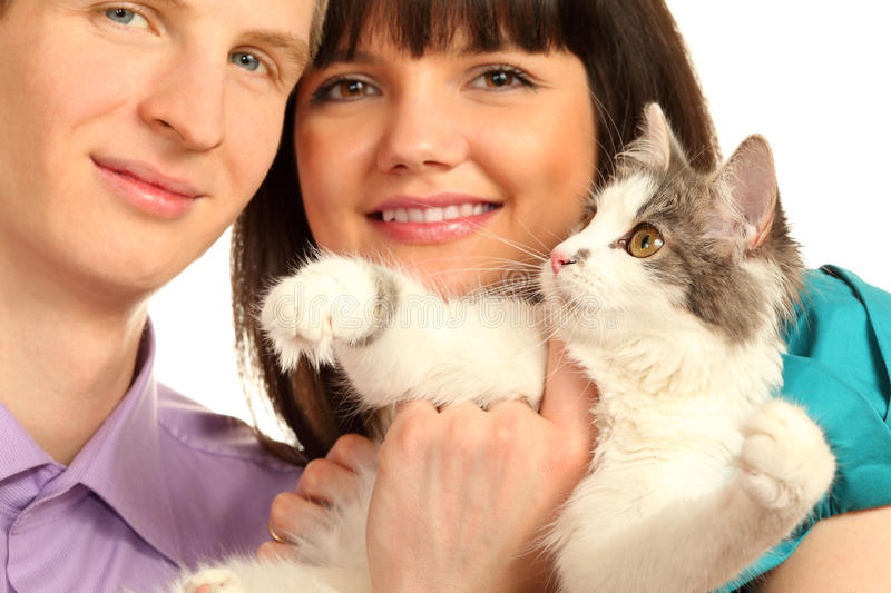 Smiling Husband And Wife Hold Cat Isolated Royalty Free Stock Photography
