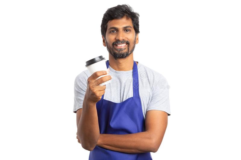 Hypermarket employee enjoying pause with coffee to go mug royalty free stock photography