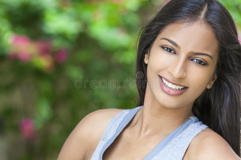 Smiling Indian Asian Young Woman Girl royalty free stock image